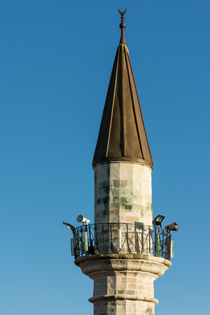 Minaret Of Old Islamic Mosque On Blue Sky photo