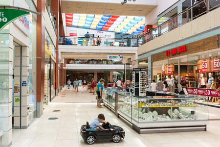 CONSTANTA, ROMANIA - AUGUST 05, 2014: People Shopping In Luxury Shopping Mall.