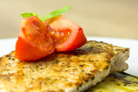 Grilled Egg Plant Slice With Pork Steak And Sliced Tomatoes photo