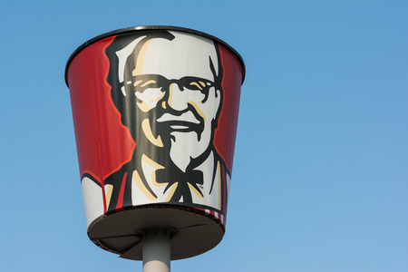 BUCHAREST, ROMANIA - AUGUST 06, 2014: Kentucky Fried Chicken Restaurant Sign. It is a fast food restaurant chain headquartered in United States specialized in chicken products.