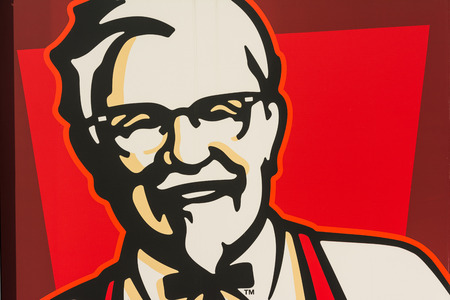 headquartered: BUCHAREST, ROMANIA - AUGUST 06, 2014: Kentucky Fried Chicken Restaurant Sign. It is a fast food restaurant chain headquartered in United States specialized in chicken products.