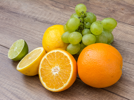 Summer Fruits Grapes And Oranges Close Up photo