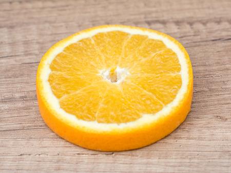 orange slice: Orange Slice On Wood Table
