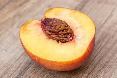 Fresh Nectarine On Wood Table photo