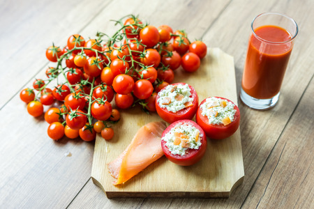 Salmon And Feta Cheese Filled Tomatoes Dinner And Tomato Juice photo