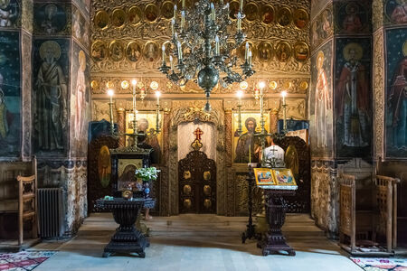 CALIMANESTI, ROMANIA - AUGUST 18, 2014: Cozia Monastery was built by Mircea the Elder in 1388 and housing his tomb is one of the most valuable monuments of national medieval art and architecture.