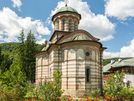 Cozia Monastery was built by Mircea the Elder in 1388 and housing his tomb is one of the most valuable monuments of national medieval art and architecture of Romania. photo
