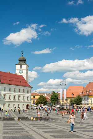 SIBIU, ROMANIA - AUGUST 18, 2014: The Main Square in the historical center was first mentioned in 1408 and is the largest public square which held public meetings, markets and public executions.