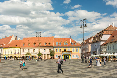 mentioned: SIBIU, ROMANIA - AUGUST 18, 2014: The Main Square in the historical center was first mentioned in 1408 and is the largest public square which held public meetings, markets and public executions.