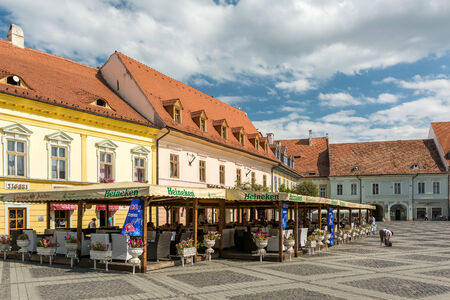 SIBIU, ROMANIA - AUGUST 18, 2014: Medieval Houses Downtown Of Sibiu Historical Center.