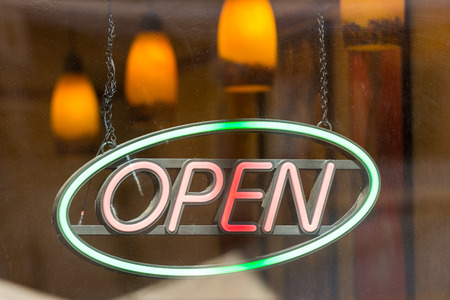 Open Store Sign In Shop Window photo