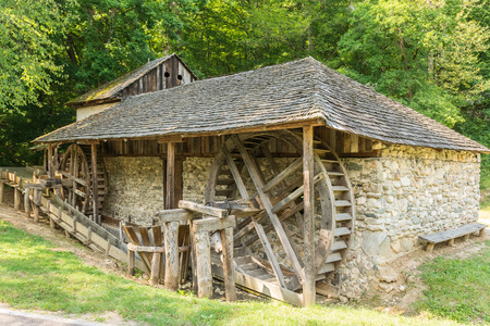 watermill: Old Wooden Watermill In Forest Editorial