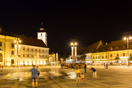 SIBIU, ROMANIA - AUGUST 19, 2014: Night Life In The Upper Town Part Of Sibiu Historical Center. The Upper Town contains most points of interest in the city and is organised around three city squares.