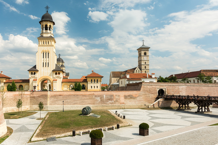 saint michael: ALBA IULIA, ROMANIA - AUGUST 20, 2014: The Coronation Orthodox Cathedral and Saint Michael Roman Catholic Cathedral are located in Carolina White Fortress Of Alba Iulia. Editorial