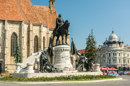 conceived: CLUJ NAPOCA, ROMANIA - AUGUST 21, 2014: The Matthias Corvinus Monument is a historic monument in Cluj-Napoca conceived by Janos Fadrusz and opened in 1902.