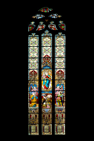 cluj: CLUJ NAPOCA, ROMANIA - AUGUST 21, 2014: Baby Jesus And Virgin Mary Stained Glass Window Inside The Gothic Roman Catholic Church of Saint Michael Built In 1390.