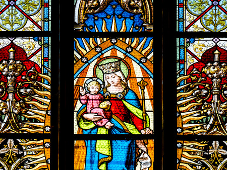 birth of christ: CLUJ NAPOCA, ROMANIA - AUGUST 21, 2014: Baby Jesus And Virgin Mary Stained Glass Window Inside The Gothic Roman Catholic Church of Saint Michael Built In 1390.