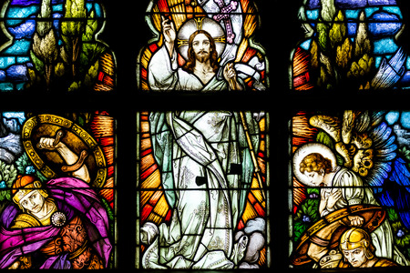 CLUJ NAPOCA, ROMANIA - AUGUST 21, 2014: Jesus Christ Resurrection Stained Glass Window Inside The Gothic Roman Catholic Church of Saint Michael Built In 1390. 에디토리얼