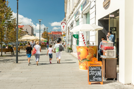old center: CLUJ NAPOCA, ROMANIA - AUGUST 22, 2014: Tourists Walking Downtown In The Old Center Of Cluj Napoca.