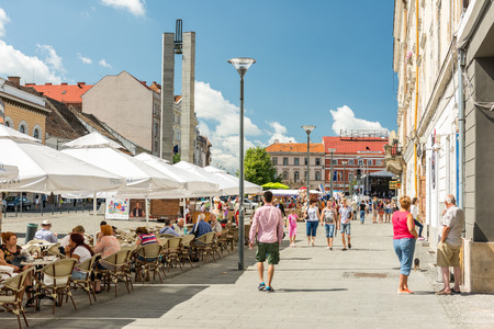 cluj: CLUJ NAPOCA, ROMANIA - AUGUST 22, 2014: Tourists Walking Downtown In The Old Center Of Cluj Napoca.