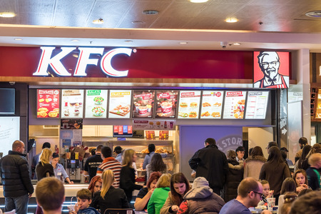 BUCHAREST, ROMANIA - NOVEMBER 29, 2014: People buying fast-food from Kentucky Fried Chicken Restaurant.