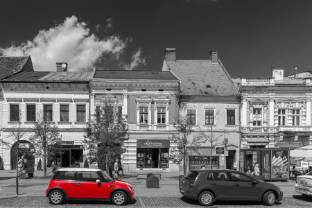 CLUJ NAPOCA, ROMANIA - AUGUST 22, 2014: Red Mini Cooper Car Downtown In The Old Center Of Cluj Napoca.