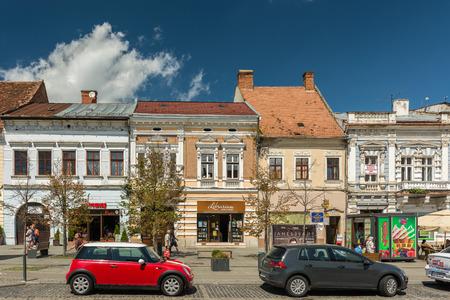napoca: CLUJ NAPOCA, ROMANIA - AUGUST 22, 2014: Red Mini Cooper Car Downtown In The Old Center Of Cluj Napoca. Editorial