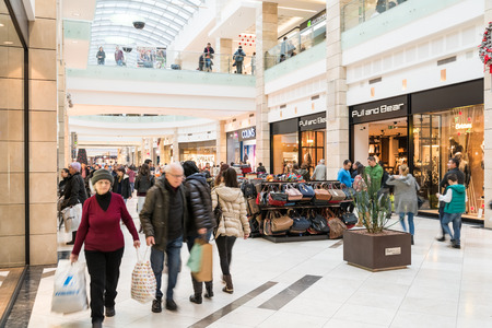 christmas shopping: BUCHAREST, ROMANIA - DECEMBER 01, 2014: People Shopping For Christmas In Luxury Shopping Mall Interior.