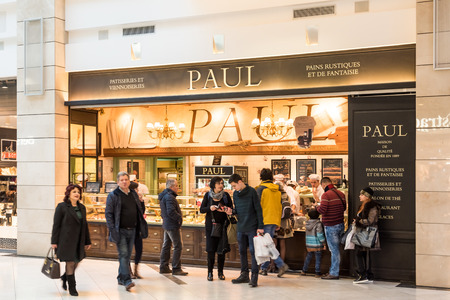 french cafe: BUCHAREST, ROMANIA - DECEMBER 01, 2014: People Buying Pastry Products At Paul Bakery restaurant, a french cafe established in 1889 in the city of Croix, in Northern France.