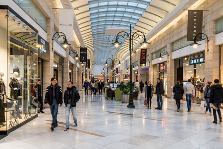 BUCHAREST, ROMANIA - DECEMBER 01, 2014: People Shopping For Christmas In Luxury Shopping Mall Interior.