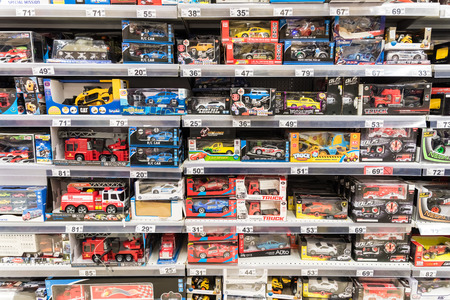 toy shop: BUCHAREST, ROMANIA - DECEMBER 06, 2014: Car Toys For Small Children On Supermarket Stand. Editorial