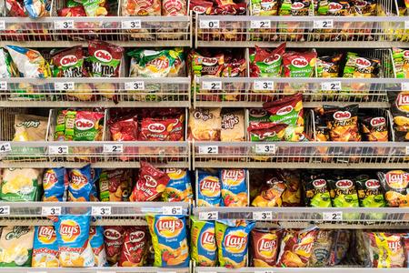 shopping binge: BUCHAREST, ROMANIA - DECEMBER 06, 2014: Fast Food Snacks On Supermarket Shelf. Editorial