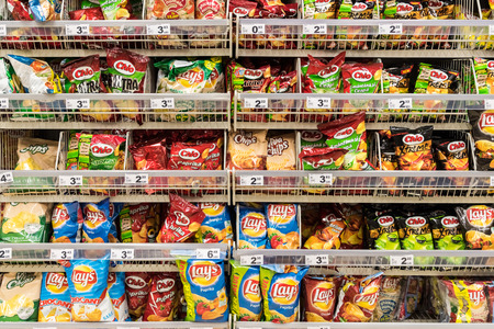 BUCHAREST, ROMANIA - DECEMBER 06, 2014: Fast Food Snacks On Supermarket Shelf. Редакционное