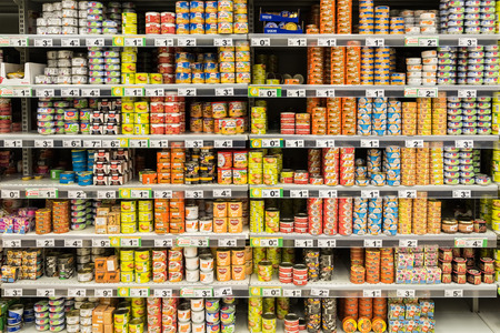 canned goods: BUCHAREST, ROMANIA - DECEMBER 06, 2014: Canned Food On Supermarket Stand.