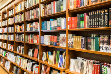 DEBRECEN, HUNGARY - AUGUST 23, 2014: Bookshelf In Library With Many International Books For Sale.