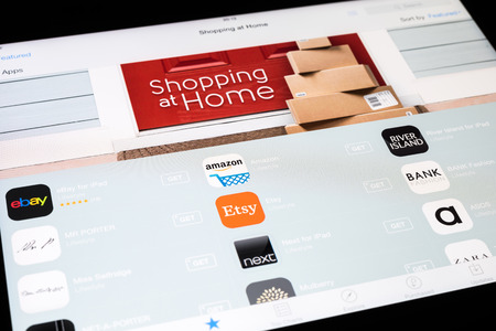 BUCHAREST, ROMANIA - DECEMBER 08, 2014: The New Shopping At Home Category In Apple Application Store On Apple iPad Air Tablet Integrates The Most Important Online Shopping Applications.
