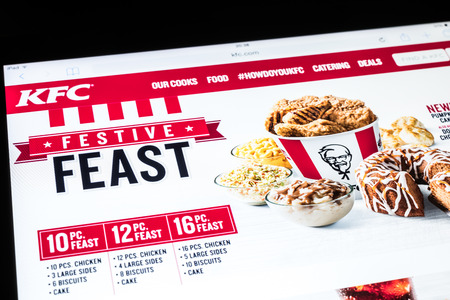 BUCHAREST, ROMANIA - DECEMBER 09, 2014: Kentucky Fried Chicken Website On Apple iPad Air Tablet. Founded in 1930 in The United States is a fast food restaurant chain that specializes in fried chicken.