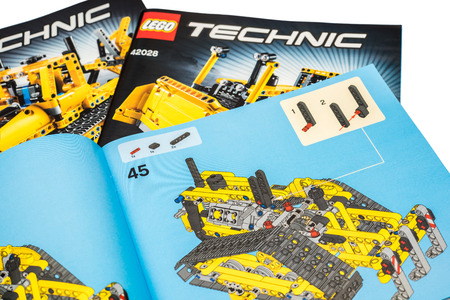BUCHAREST, ROMANIA - DECEMBER 09, 2014: Lego Technic Instruction Manuals Isolated. Technic is a line of Lego interconnecting plastic rods and parts that creates more advanced models.