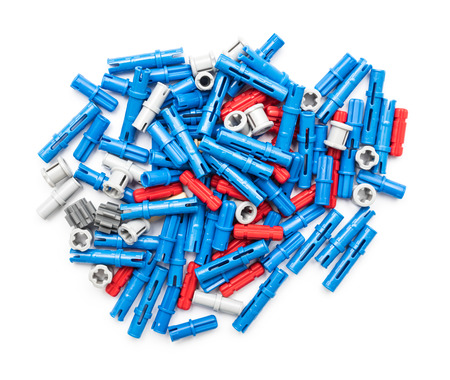 technic: BUCHAREST, ROMANIA - DECEMBER 09, 2014: Lego Technic Pieces Pile Close Up. Technic is a line of Lego interconnecting plastic rods and parts that creates more advanced models with complex movable arms.