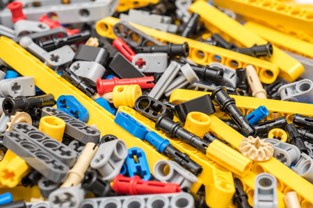 BUCHAREST, ROMANIA - DECEMBER 09, 2014: Lego Technic Pieces Pile Close Up. Technic is a line of Lego interconnecting plastic rods and parts that creates more advanced models with complex movable arms.