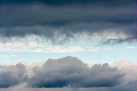 storm clouds: Rare Weather Phenomenon Of Horizontal Blue Sky Patch In Storm Clouds Stock Photo