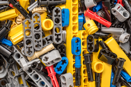 BUCHAREST, ROMANIA - DECEMBER 12, 2014: Lego Technic Pieces Pile Close Up. Technic is a line of Lego interconnecting plastic rods and parts that creates more advanced models with complex movable arms.