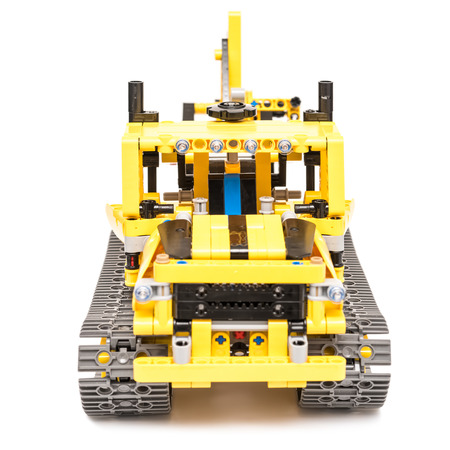 technic: BUCHAREST, ROMANIA - DECEMBER 14, 2014: Lego Technic Trench Digger Isolated. Technic is a line of Lego interconnecting plastic rods and parts that creates advanced models with complex movable arms.