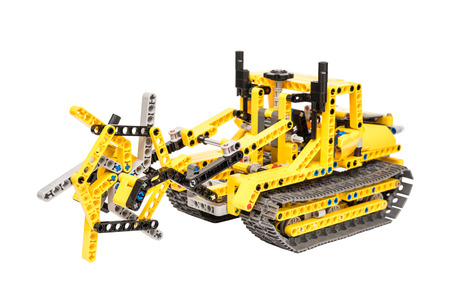BUCHAREST, ROMANIA - DECEMBER 14, 2014: Lego Technic Trench Digger Isolated. Technic is a line of Lego interconnecting plastic rods and parts that creates advanced models with complex movable arms.