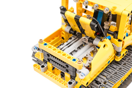 BUCHAREST, ROMANIA - DECEMBER 15, 2014: Lego Technic Engine Pistons Closeup. Technic is a line of Lego interconnecting plastic rods and parts that creates advanced models with complex movable arms.