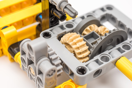 BUCHAREST, ROMANIA - DECEMBER 15, 2014: Lego Technic Engine Closeup. Technic is a line of Lego interconnecting plastic rods and parts that creates advanced models with complex movable arms.