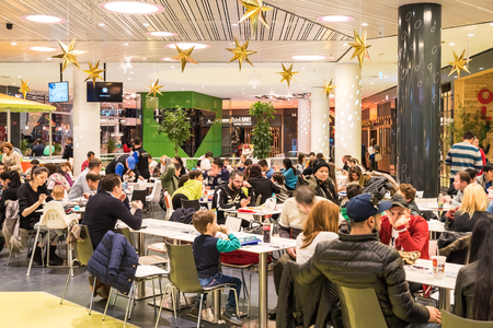 BUCHAREST, ROMANIA - DECEMBER 18, 2014: People Crowd Eating Fast Food On Restaurant Floor In Luxurious Shopping Mall.