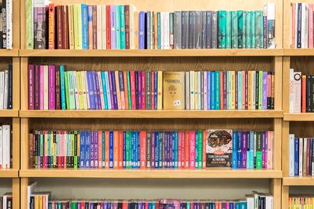 bookshelves: BRASOV, ROMANIA - DECEMBER 22, 2014: Bookshelf In Library With Many International Books For Sale.