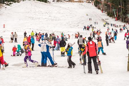 people having fun: POIANA BRASOV, ROMANIA - DECEMBER 23, 2014:  People Having Fun On Snowy Mountain Sky Resort In Poiana Brasov.