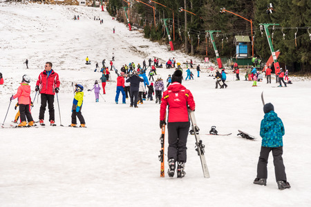 POIANA BRASOV, ROMANIA - DECEMBER 23, 2014:  People Having Fun On Snowy Mountain Sky Resort In Poiana Brasov.